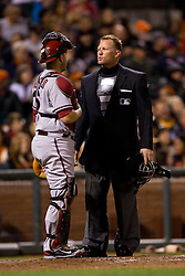 SAN FRANCISCO, CA - SEPTEMBER 09:  MLB umpire Jim Wolf #28 talks to Miguel Montero #26 of the Arizona Diamondbacks during the fourth inning against the San Francisco Giants at AT&T Park on September 9, 2014 in San Francisco, California.  The San Francisco Giants defeated the Arizona Diamondbacks 5-1.  (Photo by Jason O. Watson/Getty Images) *** Local Caption *** Jim Wolf; Miguel Montero