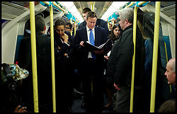 The Prime Minister working in the Tube on his way to  East London, London Thursday October 6, 2011. Photo By Andrew Parsons / i-Images.
