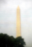 Jun 14, 2004; Washington DC, Washington, USA;  Washington Monument reflection off the stone of the Vietnam Veterans War Memorial inside Constituion Gardens. Names are out of focus.  Graphic, art, landmark.