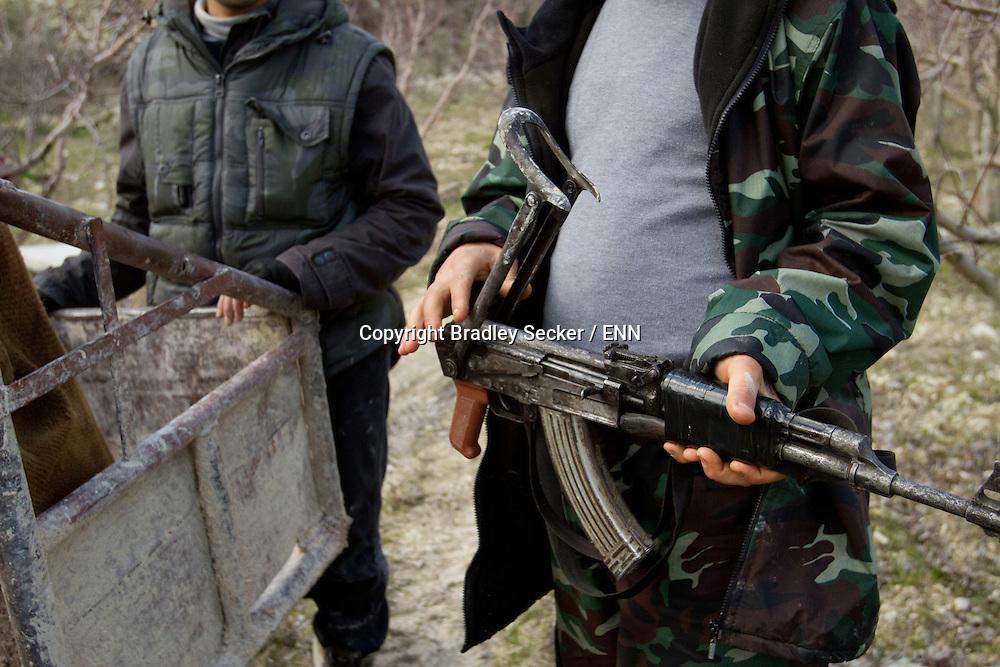 Free Syrian Army soldiers repair and test their weapons. Al Janoudiyah, Idlib province, Syria