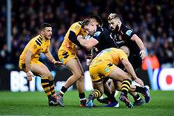 Sam Hill of Exeter Chiefs is challenged by Jacob Umaga of Wasps and Tom Cruse of Wasps  - Mandatory by-line: Ryan Hiscott/JMP - 30/11/2019 - RUGBY - Sandy Park - Exeter, England - Exeter Chiefs v Wasps - Gallagher Premiership Rugby