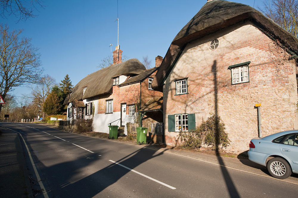 Traditional thatched cottages in the Thames village of Clifton Hampden, Oxfordshire, Uk