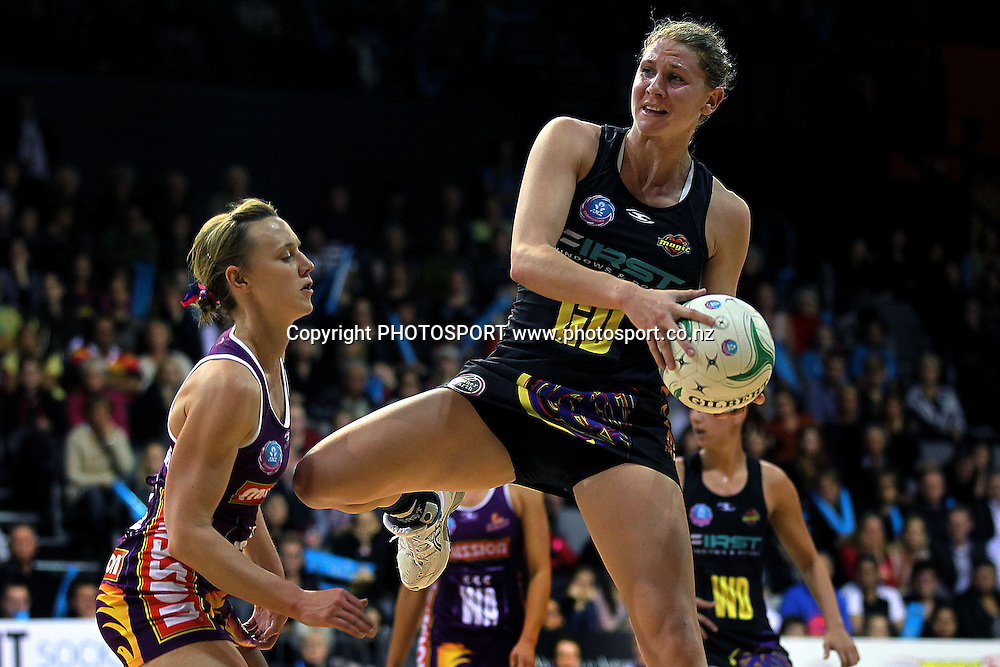Magic's Casey Williams competes against Firebirds' Natalie Medhurst. ANZ Netball Championship, Waikato/Bay of Plenty Magic v Queensland Firebirds, Claudelands Arena, Hamilton, New Zealand. Monday 2nd July 2012. Photo: Anthony Au-Yeung / photosport.co.nz