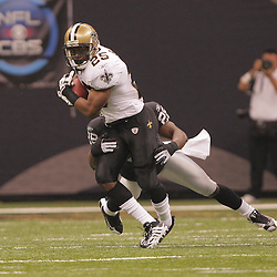 2008 October, 12: New Orleans Saints running back Reggie Bush (25) runs as Oakland Raiders SS Gibril Wilson (28) attempts a tackle during a week six regular season game between the Oakland Raiders and the New Orleans Saints at the Louisiana Superdome in New Orleans, LA.