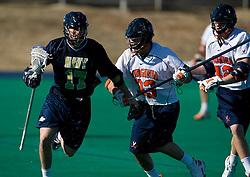Navy midfielder Michael Beggins (17) runs past Virginia defenseman Matt Kelly (33).  The Virginia Cavaliers scrimmaged the Navy Midshipmen in lacrosse at the University Hall Turf Field  in Charlottesville, VA on February 2, 2008.