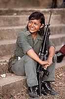 ca. March 1983, La Palma, El Salvador --- Portrait of a female guerrilla soldier in La Palma, El Salvador. --- Image by © Owen Franken