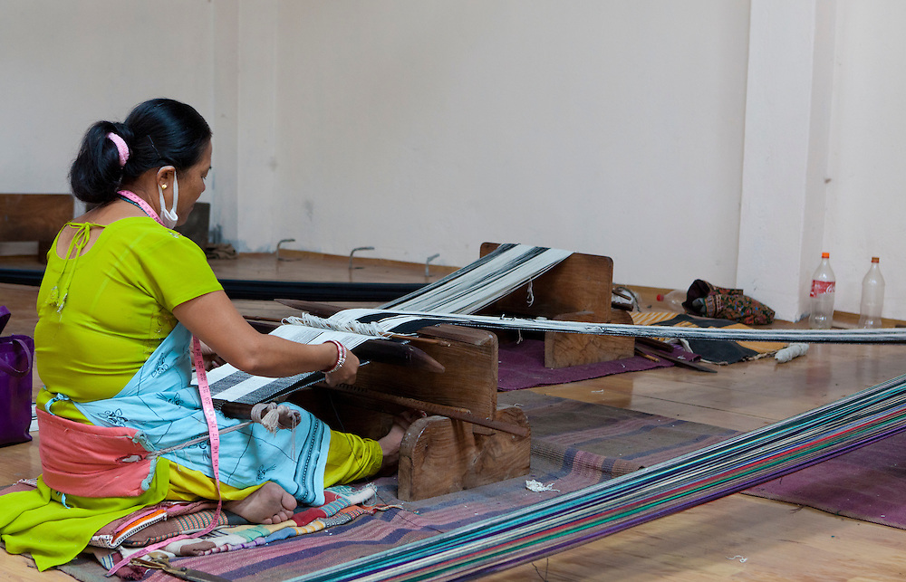 A Nepali woman operating a weaving loom at Womens Skills Development Project in Pokhara, Nepal. The WSDP was set up in 1975 as a non-profit, fair trade organization to help disadvantaged women in Nepal.