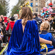 Two young girls pose on the back of an old convertible at the parade at Montmartre's 80th Harvest Festival, the Fete des Vendanges in Montmartre, Paris, France on October 12, 2013. The parade is an annual celebration of food and love in the 18th arrondissement of Paris.