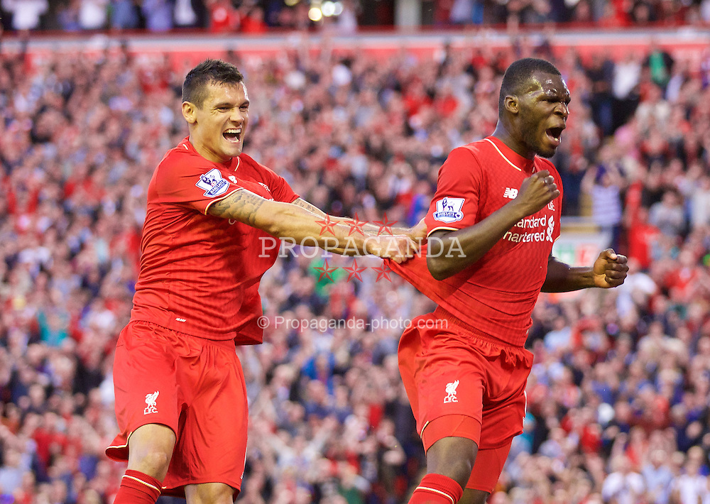 LIVERPOOL, ENGLAND - Monday, August 17, 2015: Liverpool's Christian Benteke celebrates scoring the first goal against AFC Bournemouth with team-mate Dejan Lovren during the Premier League match at Anfield. (Pic by David Rawcliffe/Propaganda)