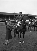 "07/08/1980<br /> 08/07/1980<br /> 07 August 1980<br /> R.D.S. Horse Show: John Player Top Score Competition, Ballsbridge, Dublin.  Harvey Smith (Great Britain) winner, on ""Sanyo Music Centre"" receiving the John Player Lance from Mrs Oliver Casey, wife of the Managing Director John Player."