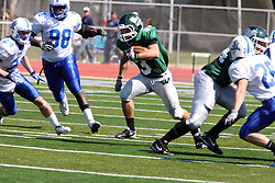 17 September 2011: T.J. Stinde cuts up the middle during an NCAA Division 3 football game between the Aurora Spartans and the Illinois Wesleyan Titans on Wilder Field inside Tucci Stadium in.Bloomington Illinois.