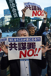 May 23, 2017 - Tokyo, Japan - Protesters shout slogans denouncing a pending anti-conspiracy bill during a rally in front of the National Diet building in Tokyo. Japan is expected a passage of legislation to punish those found guilty of planning serious crimes is raising protests over potential expansion of state powers that critics fear could be used to undermine basic civil liberties. Tokyo says the legal changes are needed to ratify a U.N. treaty aimed at battling international organized crime and fighting terrorism, as Tokyo prepares to host the 2020 Olympics. (Credit Image: © Alessandro Di Ciommo via ZUMA Wire)