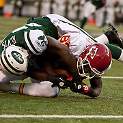 Dec 11, 2011; East Rutherford, NJ, USA; New York Jets corner back Darrelle Revis (24) tackles Kansas City Chiefs wide receiver Dwayne Bowe (82) during the second half at MetLife Stadium. Jets won 37 - 10