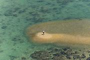 Man on sand bar.