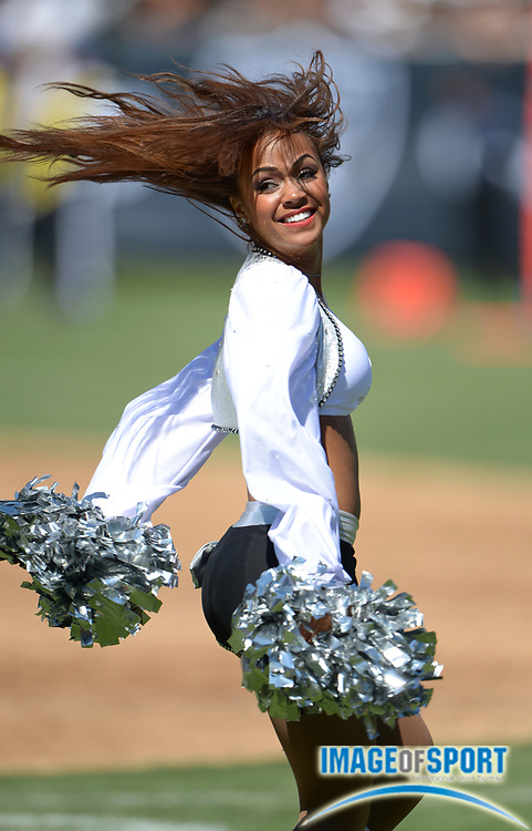 Sep 15, 2013; Oakland, CA, USA; Oakland Raiders cheerleader Victoria Braga perform during the game against the Jacksonville Jaguars at O.co Coliseum.