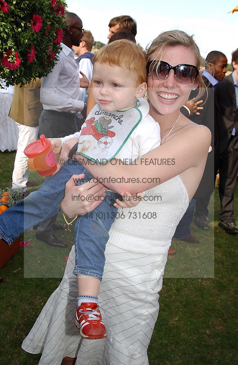 Actress CAMILLA RUTHERFORD and her son HECTOR ABBOTT at the Veuve Clicquot sponsored Gold Cup or the British Open Polo Championship won by The  Azzura polo team who beat The Dubai polo team 17-9 at Cowdray Park, West Sussex on 18th July 2004.