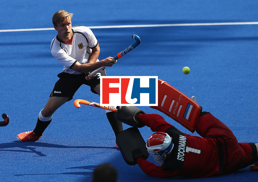 RIO DE JANEIRO, BRAZIL - AUGUST 18:  Jaap Stockman, the Netherlands goalkeeper saves a shot from Linus Butt (L) during the Men's Bronze Medal match between the Netherlands and Germany on Day 13 of the Rio 2016 Olympic Games held at the Olympic Hockey Centre on August 18, 2016 in Rio de Janeiro, Brazil.  (Photo by David Rogers/Getty Images)