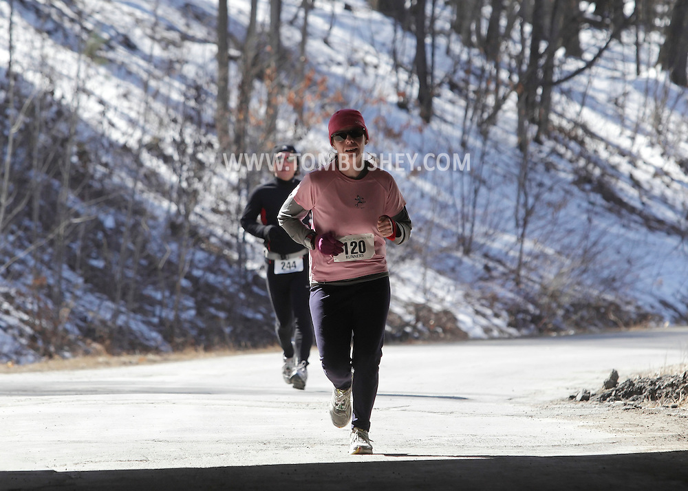 Mamakating, New York - Runners approach a tunnel during the Wurtsboro Mountain 30K road race on March 20, 2011.