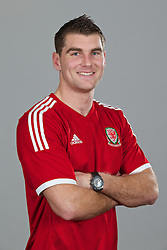 CARDIFF, WALES - Thursday, November 14, 2013: Wales' Sam Vokes wearing the new Wales 2013/2014 Adidas home jersey. (Pic by David Rawcliffe/Propaganda)