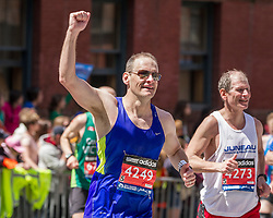 2014 Boston Marathon: triumphant runner heading for the finish line