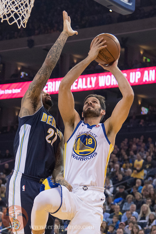 January 8, 2018; Oakland, CA, USA; Golden State Warriors forward Omri Casspi (18) shoots the basketball against Denver Nuggets forward Wilson Chandler (21) during the first quarter at Oracle Arena. The Warriors defeated the Nuggets 124-114.