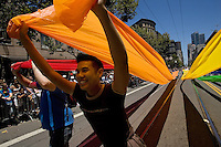 SAN FRANCISCO, CA - JUNE 24 : Nam Nguyen carries part of a colored cloth flag as he takes part in the 37th annual LBGT Pride Parade on June 24, 2007 in San Francisco, California. Hundreds of thousands of people lined the streets of San Francisco to watch and take part in the parade.  (Photograph by David Paul Morris)