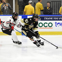 BUFFALO, NY - SEP 21,  2017: Ontario Junior Hockey League Governors Showcase game between the Trenton Golden Hawks and Milton Icehawks, Emile Galarneau #9 of the Milton Icehawks tries to keep the puck from during the third period.<br /> (Photo by Andy Corneau / OJHL Images)