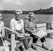 3 old immigrant ladies enjoying a day by the water