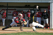 Hilton catcher Dominic Palma tags Greece Athena's Dominic DiStefano out at the plate during a game in Hilton on Wednesday, April 27, 2016.