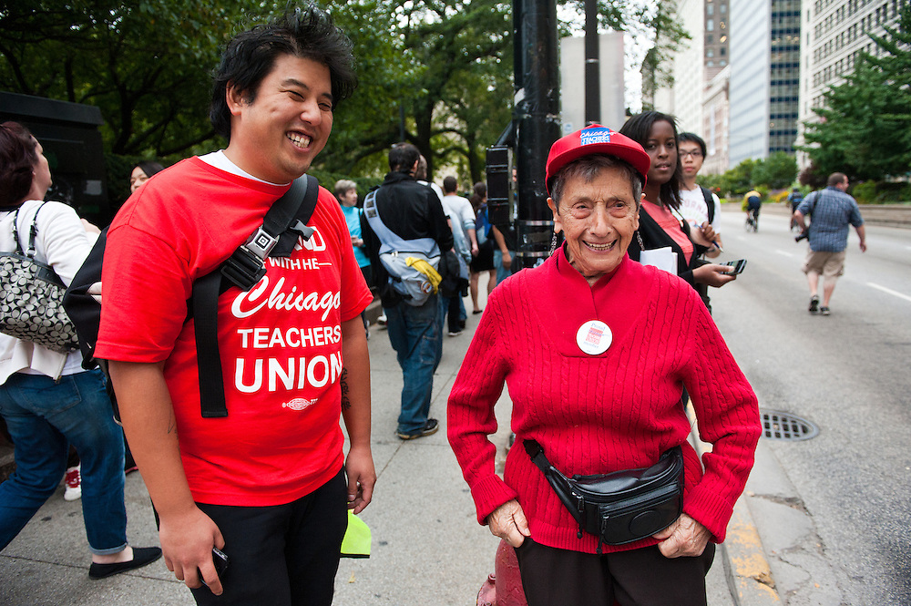 Chicago Teachers Union members watch as teachers and allies march down Michigan Avenue to Grant Park on September 13, 2012.