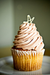 Cupcake with tall frosting on a plate