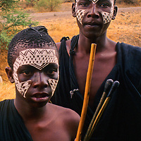 Africa, Tanzania. Maasai boys after emorata,  the circumcision rite of passage.  They must wander in small groups and fend for themselves to prepare for moranhood, or manhood.