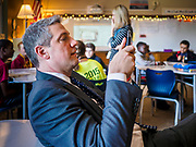"08 APRIL 2019 - DES MOINES, IOWA: Rep. TIM RYAN uses his smart phone to take a picture during a classroom visit at Callanan Middle School. Ryan, a candidate for the Democratic ticket of the US presidency, visited Callanan Middle School in Des Moines to discuss education issues. Ryan declared his candidacy on the US television show ""The View"" on April 4. Ryan, 45 years old, represents Ohio's 13th District, which includes Lordstown, where a large General Motors plant recently closed. He is the latest Democrat to announce his candidacy to be the Democratic nominee in the 2020 election. Iowa holds its presidential caucuses on Feb. 3, 2020.      PHOTO BY JACK KURTZ"