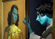 "© Licensed to London News Pictures. 18/03/2013. London, UK Cabaret singer Tricity Vogue, whose successful Edinburgh Fringe Theatre Festival performances were inspired by 'Chinese Girl' poses with the original painting. Press call before the auction of ""Chinese Girl"" by Vladimir Tretchikoff at Bonhams in London today 18th March 2013. The painting is said to be the most widely reproduced and recognisable painting in the world because of its wide reproduction in 1950's art prints. It is expected to fetch 300,000-500,000 GBP at auction on the 20th March. Photo credit : Stephen Simpson/LNP"