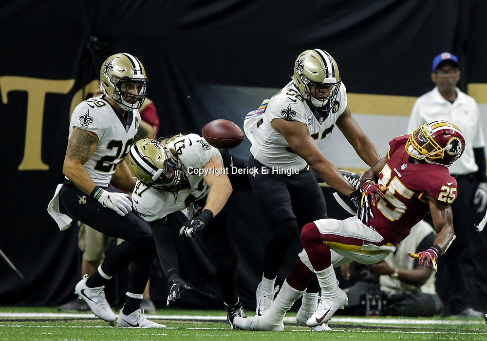 Oct 8, 2018; New Orleans, LA, USA New Orleans Saints linebacker Alex Anzalone (47) breaks up a two point conversion attempt to Washington Redskins running back Chris Thompson (25) during the fourth quarter at the Mercedes-Benz Superdome. The Saints defeated the Redskins 43-19.