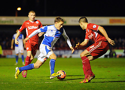 Bristol Rovers' Eliot Richards takes on Crawley Town's Matthew Sadler - Photo mandatory by-line: Seb Daly/JMP - Tel: Mobile: 07966 386802 08/01/2014 - SPORT - FOOTBALL - Broadfield Stadium - Crawley - Crawley Town v Bristol Rovers - FA Cup - Replay
