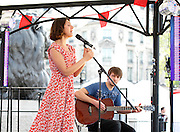 Feast of St George 2014<br /> Trafalgar Square <br /> London <br /> United Kingdom<br /> 21st April 2014 <br /> <br /> <br /> Stella &amp; &quot;The Shakes&quot; perform on the bandstand stage in Trafalgar Square (formerly known as StaellaStar). They are current holders of the &ldquo;Mayor's Big Busk Gigs 2013 Groups category &amp; of the Champion award. <br /> <br /> The band include Will Jackson (drums), Jack Gillen (pictured on guitar), Lyle Holloway (bass) and  Stella Charalambous, vocals. Their debut EP is called Blossom.