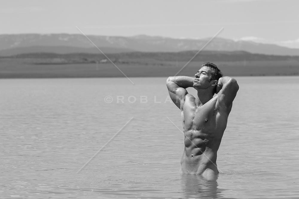 muscular man in a lake