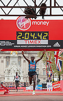 Eliud Kipchoge of Kenya crosses the finishing line on The mall to win The Virgin Money London Marathon in a time of 2:04:42, Sunday 26th April 2015.<br />