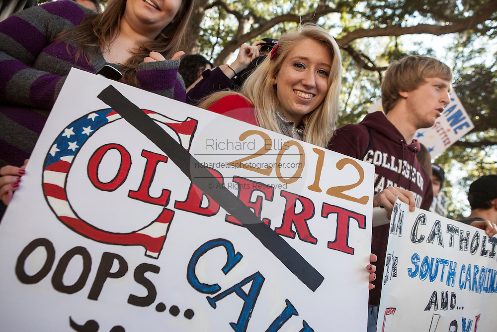 Students hold signs supporting Comedian Stephen Colbert during a rally with former Republican presidential candidate Herman Cain at the College of Charleston on January 20, 2012 in Charleston, South Carolina. Colbert held the event with Cain, titled Rock Me Like a Herman Cain South Cain-olina Primary Rally, as part of his pseudo-run for president of The United States of South Carolina.