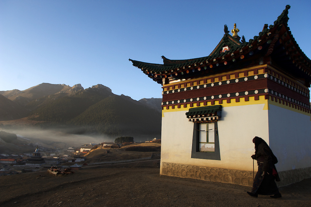 Pilgrims walk the kora which surrounds the town of Langmusi in Gansu Province.