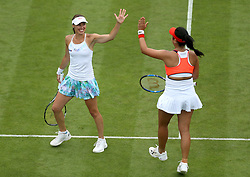 Switzerland's Martina Hingis (left) and Chinese Taipei's Yung-Jan Chan celebrate a point during the Women's Doubles Final against Australia's Ashleigh Barty and Casey Dellacqua during nine of the AEGON International at Devonshire Park, Eastbourne.