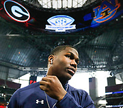Auburn running back Kerryon Johnson (21) puts in his earbuds while walking back to the Auburn locker room after a team prayer two hours before the start of the SEC Championship game between the #2 Auburn Tigers and the #6 Georgia Bulldogs in Mercedes-Benz Stadium in Atlanta, Georgia, on Saturday, Dec. 2, 2017. (Photo/Casey Sykes, csykes@mlive.com, www.caseysykes.com)