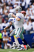 DALLAS, TX - JANUARY 13:   Tony Romo #9 of the Dallas Cowboys throws a pass against the New York Giants during the NFC Divisional playoff at Texas Stadium on January 13, 2008 in Dallas, Texas.  The Giants defeated the Cowboys 21-17.  (Photo by Wesley Hitt/Getty Images) *** Local Caption *** Tony Romo