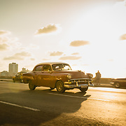 Vintage cars on the Melecon at sunset