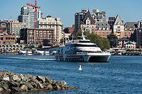The Coho Ferry leaves Victoria, BC, which features a mix of historical and new buildings on the Inner Harbour.