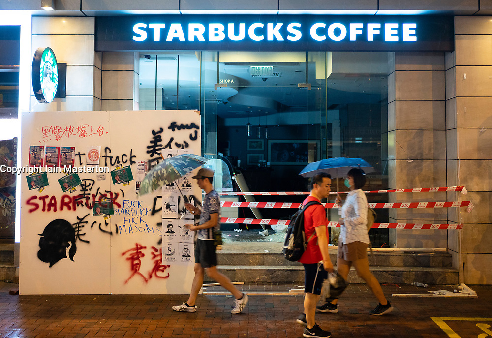 Hong Kong. 6 October 2019. Tens of thousands of pro-democracy protestors march in pouring rain through centre of Hong Kong today from Causeway Bay to Central. Peaceful march later turned violent as a hard-core of protestors confronted police. Pic; Vandalised branch of Starbucks coffee in Causeway Bay .Iain Masterton/Alamy Live News.