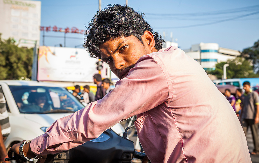 Portrait of a man on a motor scooter in Pune, India.