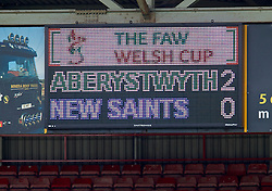 WREXHAM, WALES - Saturday, May 3, 2014: The scoreboard shows Aberystwyth Town taking a two goal lead against The New Saints during the Welsh Cup Final at the Racecourse Ground. (Pic by David Rawcliffe/Propaganda)