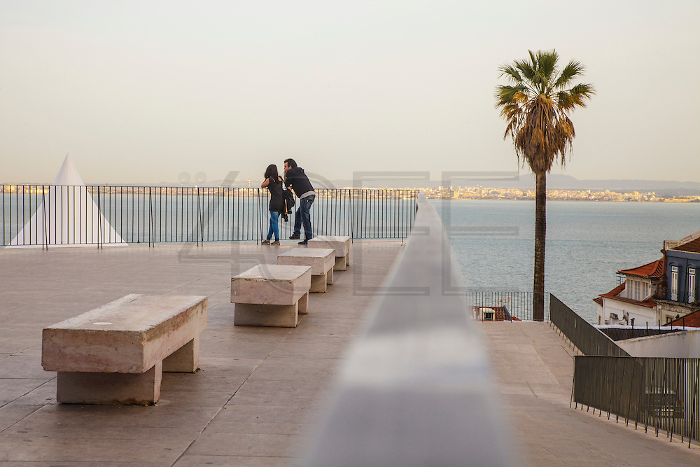 A couple in Portas do Sol lookout in Lisbon.